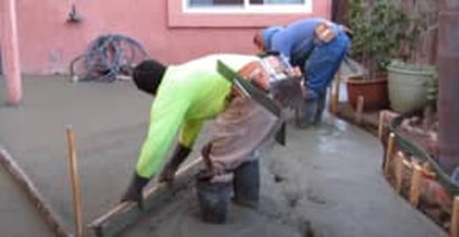 Concrete pouring finishers in prescott to a concrete porch.